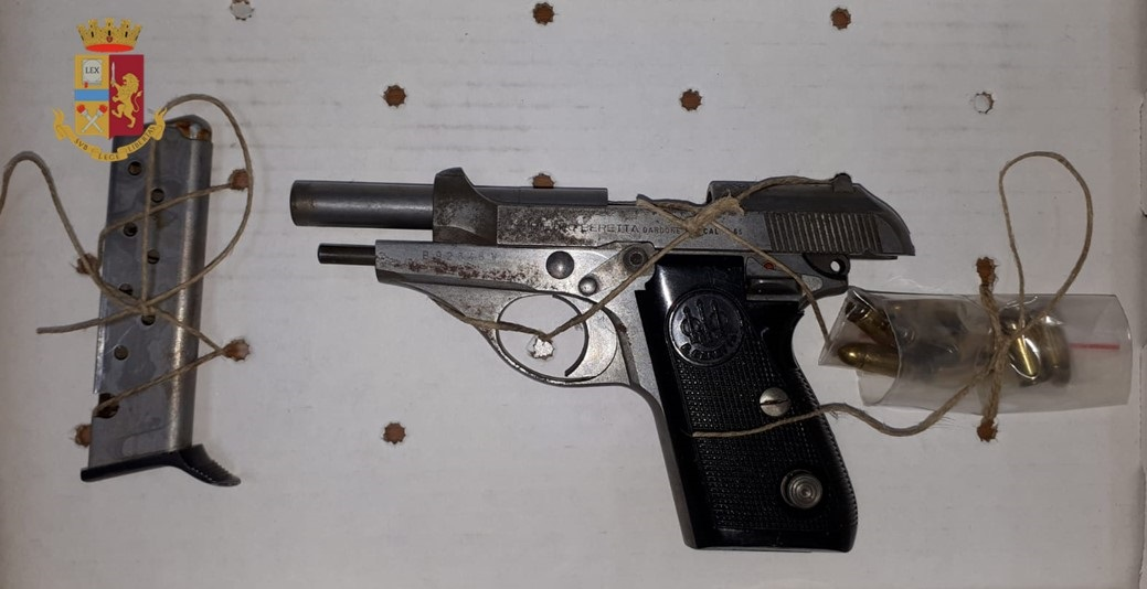 8-Pistola