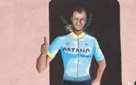 """Tortolì, un murales in memoria del ciclista Michele Scarponi. Mascia: """"Ora pedala tra le nuvole"""""""